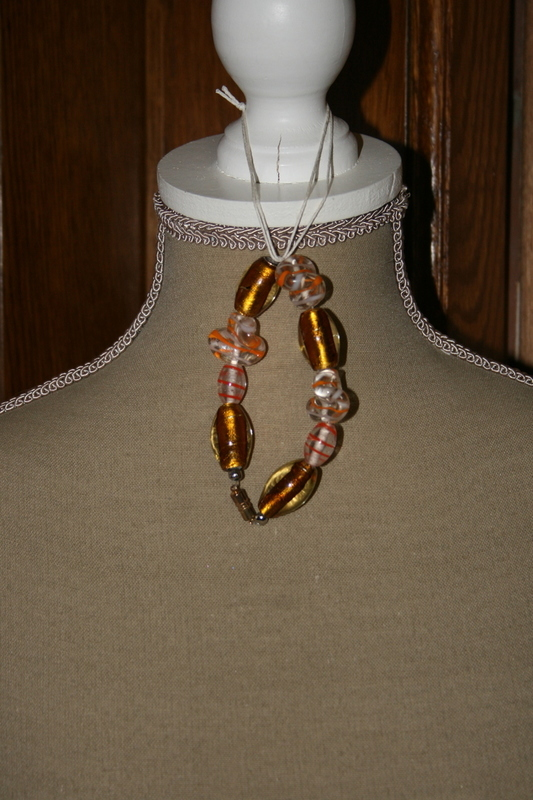 Armband met zilverfolie glaskralen (oranje)    VERKOCHT