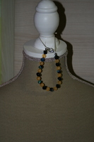 Armband met glaskralen (zwart met geel)