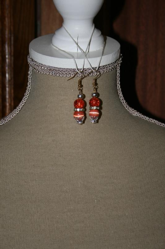 Oorbellen met glaskralen - cat-eye parels (Oranje)