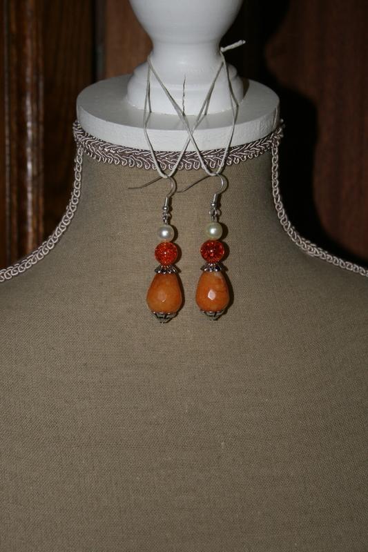 Oorbellen met glaskralen - kristal - glas parels (op z'n oranje)